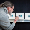 ULAY photographed while inspecting the polaroids at the framer (photo: Profilex)